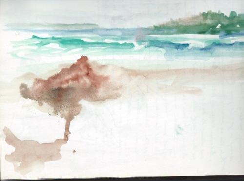 Thatched umbrella on white sand